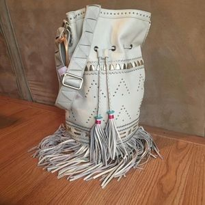 Tassled fringe leather bucket bag